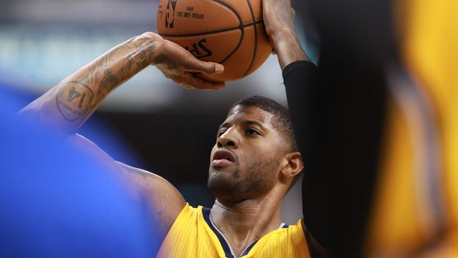 Indiana Pacers forward Paul George (13) shoots a free throw against the Philadelphia 76ers  during the first half at Bankers Life Fieldhouse.