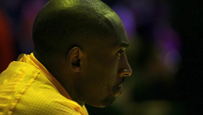 Kobe Bryant of the Los Angeles Lakers sits on the bench during pregame introductions before a 2012 game against the Phoenix Suns.