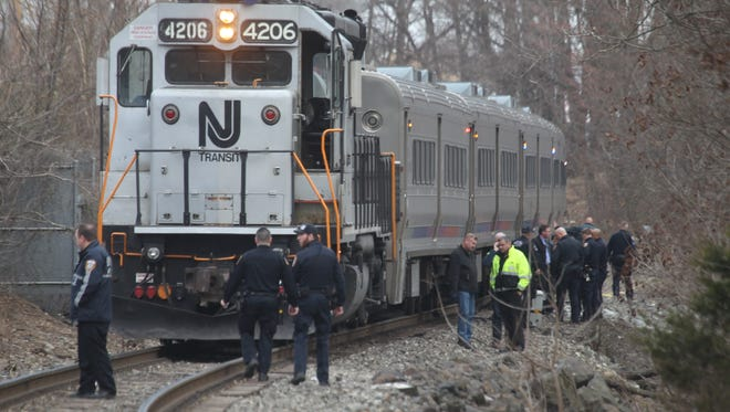 Police and emergency workers respond to a man who was hit by a commuter train Spring Valley on Tuesday.