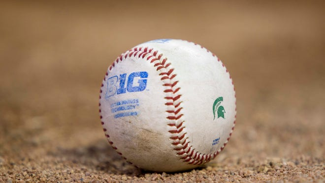 A ball from the third-round Big Ten tournament game won by Illinois, 2-0,  between Michigan State and Illinois rests on the edge of the field on May 22, 2015, in Minneapolis.