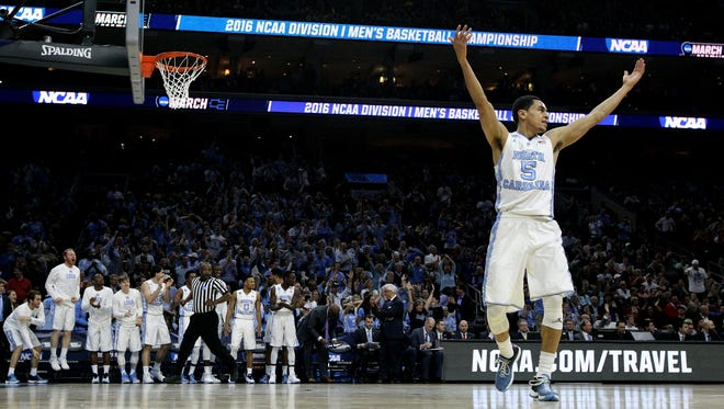 Marcus Paige celebrates after a basket in the first half against the Indiana Hoosiers during the 2016 NCAA Men's Basketball Tournament East Regional at Wells Fargo Center.