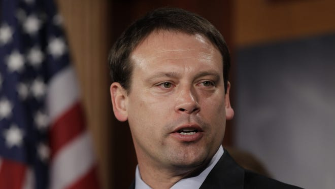Rep. Heath Shuler, D-N.C., speaks about Democrats and Republicans sitting together during President Barack Obama's State of the Union speech, Tuesday, Jan. 25, 2011, on Capitol Hill in Washington. (AP Photo/Charles Dharapak)