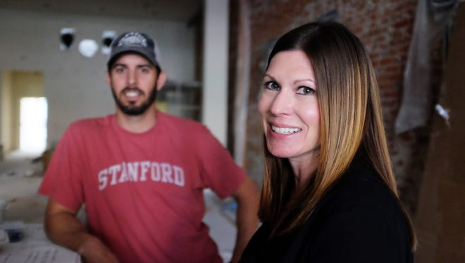 Colin and Lauren Hattersley look forward to cutting the ribbon at the Farmer's Union Pour House, a new business they are opening on Main Street in Salinas.