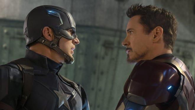 Captain America (Chris Evans, left) and Iron Man (Robert Downey Jr.) are at odds in 'Captain America: Civil War.'