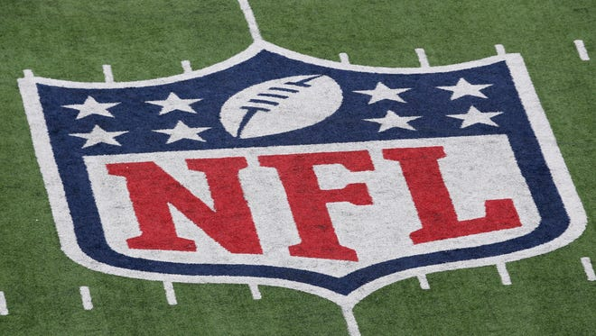 File photo: A detail of the official National Football League NFL logo on a field in New Jersey before a game.