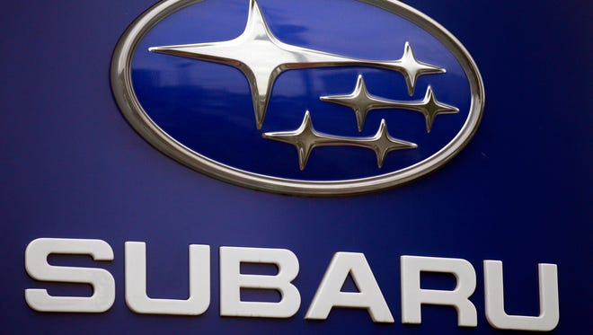 In this Aug. 31, 2011, file photo, a Subaru logo is displayed on a sign at a dealer's lot, in Portland.