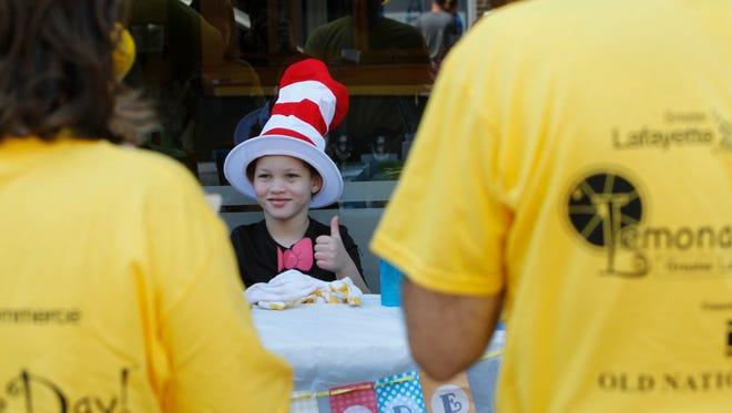 Lemonade Day entrepreneur Eddie Essex, 5, gives judges the thumbs up after serving them glasses of his lemonade.