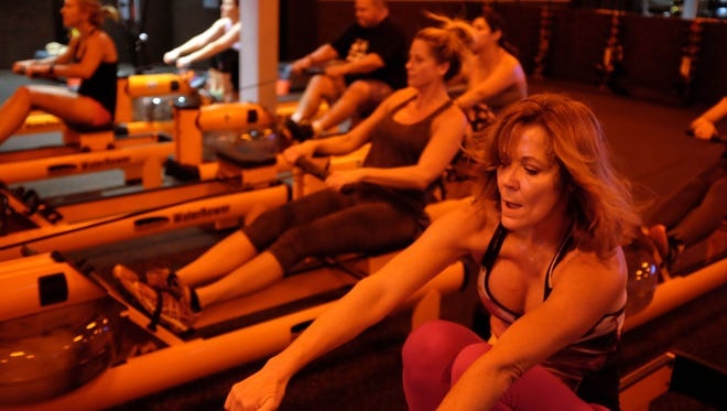 Students workout at Orangetheory Fitness in Palm Desert on June 8, 2016. All students wear a heart monitor as they go through their one-hour total body workout.