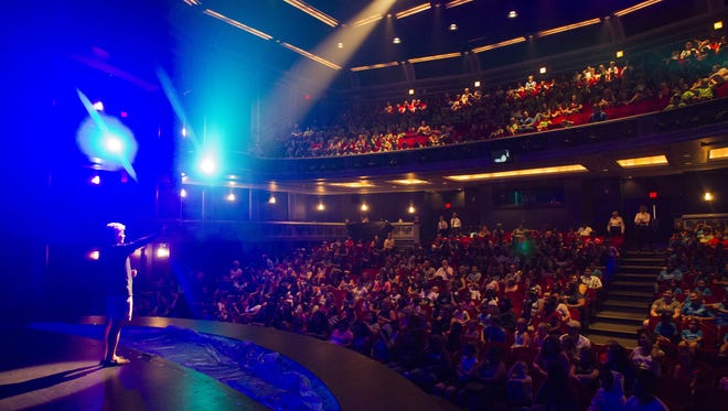 """Valley Youth Theatre producing artistic director Bobb Cooper warms up the crowd on Tuesday, June 21, 2016, at Herberger Theater Center in Phoenix. Valley Youth Theatre sponsored seats for 550 underprivileged and at-risk kids to watch their production of Disney's """"The Little Mermaid."""""""