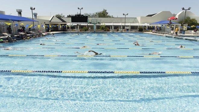 Members of the Scottsdale Aquatic Club swim practice laps on June 22, 2016, at the Scottsdale Aquatic Club in Scottsdale.