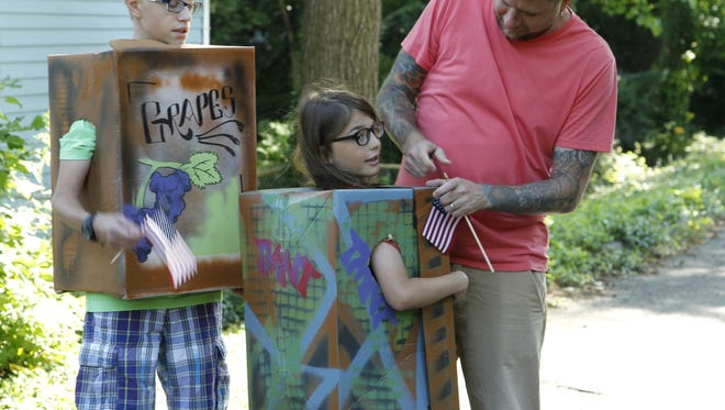 Kids get ready with spray-painted boxes for the Children's Box Parade Saturday, June 25, 2016