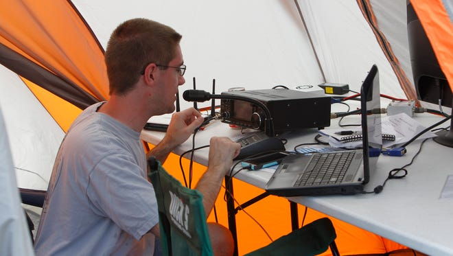 Amateur radio operator Kevin Lambert reaches out across the country Sunday during a 24-hour competition to simulate disaster communications.