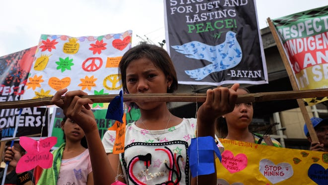 Indigenous people join a march to voice their demands such as free education and respect for their ancestral domains, as well as to show support for Rodrigo Duterte during his oath to office on June 30, 2016 in Manila, Philippines.