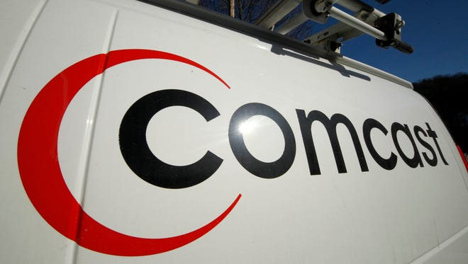 FILE - This Feb. 11, 2011 file photo shows the Comcast logo on one of the company's vehicles, in Pittsburgh. (AP Photo/Gene J. Puskar, File)