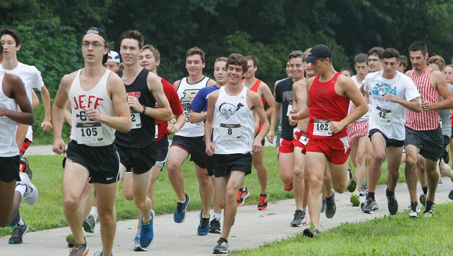Local cross-country runners, as well as Jeff alumni runners, take off on a 5K run on the city's abandoned golf course, which Jeff coaches hope can become the school's home course.