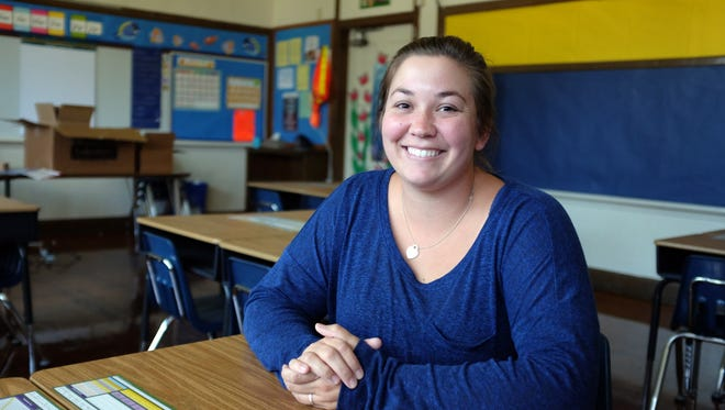 At a student desk in her classroom, teacher Danielle Gonzales is looking forward to the first day of school tomorrow at Roosevelt Elementary in Salinas.