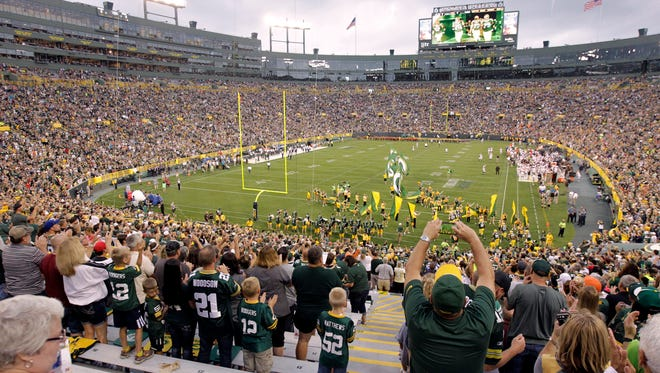 The Green Bay Packers take to the field for their game against the Cleveland Browns.