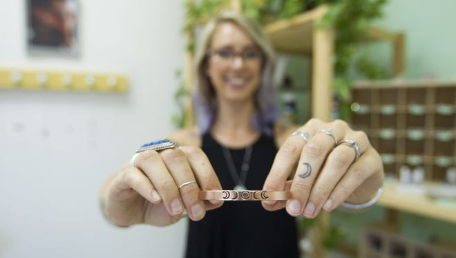 Cassie Uhl poses for a portrait at Zenned Out in Tempe on Tuesday, Aug. 9, 2016. Zenned Out, which Uhl founded and owns, is a jewelry store by women and for women, making pieces to promote female empowerment.