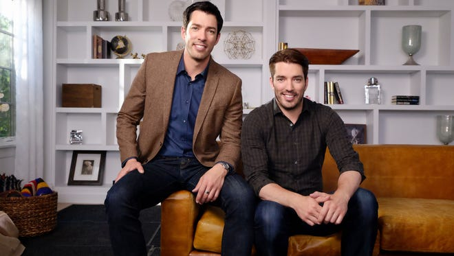 """Drew, left, and Jonathan Scott star on HGTV's 'Buying & Selling""""  where they help couples update and sell outdated homes and then buy their dream homes."""