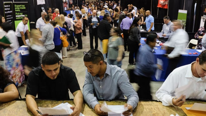 Ricardo Chavez, left, of Coachella and Juan Avalos, of Indio fillout job applications at the  21st annual ValleyWide Employment Expo at the Riverside County Fairgrounds on Thursday, September 15, 2016. The two say they are looking for work in the hospitality industry.