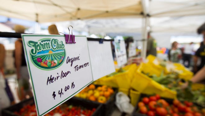 A display of organic heirloom tomatoes is pictured at Uptown Farmers Market on the corner of Central Avenue and Bethany Home Road in Phoenix on Saturday, Oct. 1, 2016.