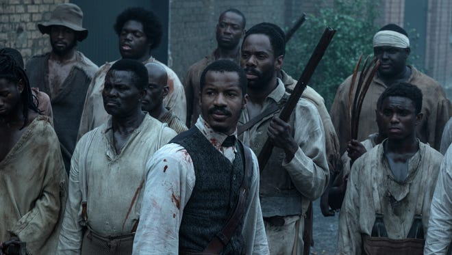 """Nate Parker (center) plays Nat Turner, the leader of a slave rebellion in the southern United States, in """"The Birth of a Nation."""""""