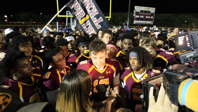 Phoenix Mountain Pointe senior QB Noah Grover (13) gives an interview after defeating Mountain View at Mountain Pointe High School in Phoenix on Friday, Sept. 16, 2016.