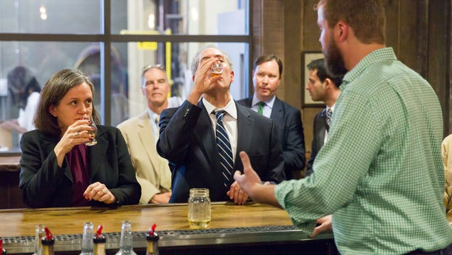 U.S. Trade Representative Michael Froman samples whiskey at Green Brier Distillery in Nashville, Tenn., on Friday, Oct. 28, 2016. Froman visited the distillery to promote the Trans Pacific Partnership agreement that he said could eliminate duties on exported whiskey of up to 45 percent. (AP Photo/Erik Schelzig)