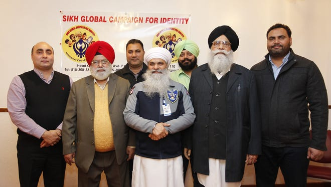 Members of the Wisconsin and Illinois Sikh community attend a meeting in Milwaukee to call attention to hate crimes.