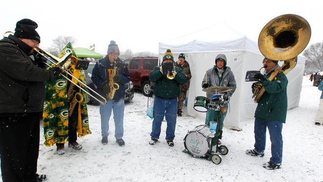 The Packers tailgate band  entertains fans before  the Green Bay Packers- Seattle Seahawks NFL football game at Lambeau Field in Green Bay Wisconsin, Sunday, December 11, 2016. Milwaukee Journal Sentinel photo by Rick Wood/RWOOD@JOURNALSENTINEL.COM   