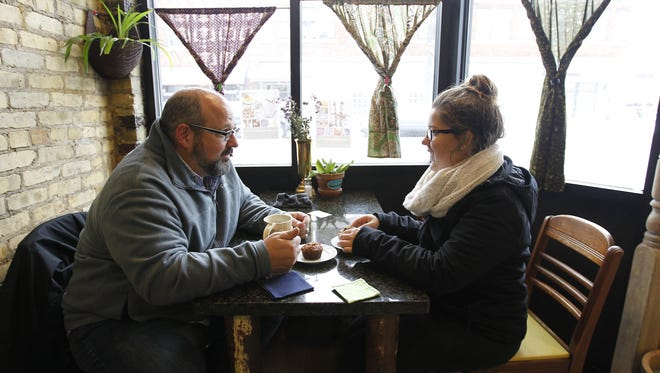 Matt Stippich of Wauwatosa and his daughter Kaitlin have coffee and carrot apple muffins Saturday at the Tricklebee cafe.