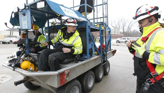 Crews members on 8-wheeled tunnel inspection vehicle are (from left) Bob Thomson, who monitors video recording, driver Lucas Zanter, and Justin Scherf, who monitors air quality during inspection of the Northwest Side deep tunnel. They are employed by National Power Rodding Corp. of Chicago. Here they check radio communications before they are lowered into tunnel access shaft at Milwaukee County grounds. Pat A. Robinson / Milwaukee Journal Sentinel    ------------------------------------------------------------------------------------------------------------------------ ________________________________________________________________ Summary: Need photos of MMSD contractor using crane to lower 8-wheeled vehicle down a shaft to begin inspection of Northwest Side deep tunnel. Photos to accompany TUNNEL package online Wednesday for Thursday paper. This is first time Northwest Side deep tunnel has been inspected since it was completed in 2006.