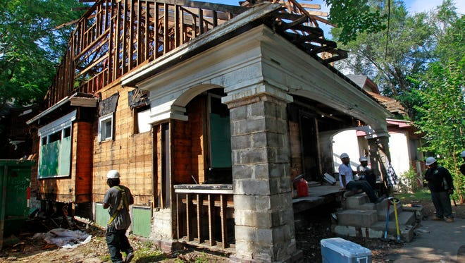 This home at 2709 N. 40th St. in Milwaukee was being deconstructed for salvage and recycling in September. Milwaukee Mayor Tom Barrett held a press conference at the site to  highlight the deconstruction program that trains workers for jobs in construction trades in the Sherman Park neighborhood.