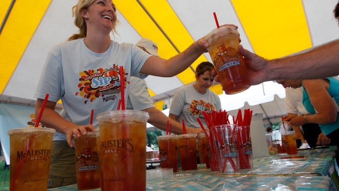 Rebecca Day serves up McAlister's Deli  famous sweet tea during the 32nd Annual New York Mississippi Picnic, Saturday, June 11, 2011 in New York's Central Park.  (AP Photo/Mary Altaffer)