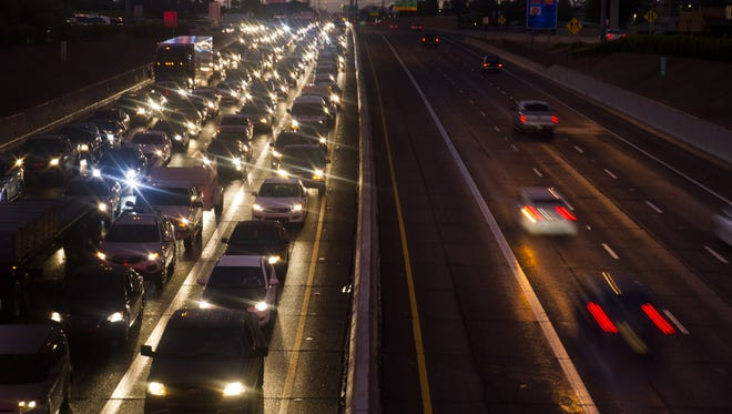 Cars sit in a traffic jam caused by a monsoon rainstorm on Interstate 17 southbound in Phoenix on Aug. 2, 2016.
