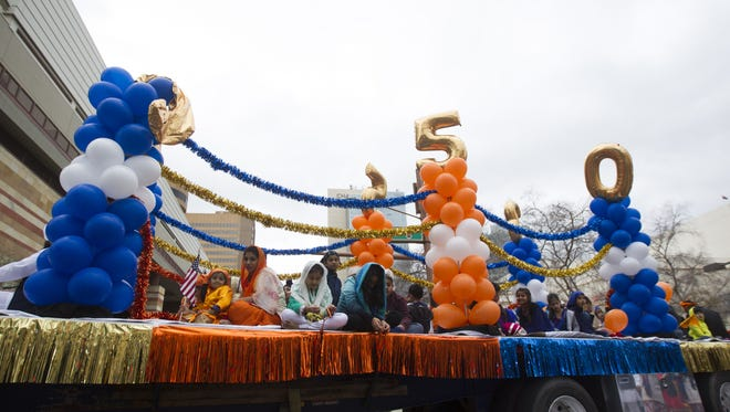 Members of Arizona's Sikh community march in a parade during festivities for Sikh Awareness and Identity Day in downtown Phoenix on Sunday, Jan. 15, 2017.