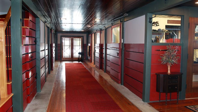 A long wide hallway separates what used to be horse stalls at the home of Jon and Joan Scholz,