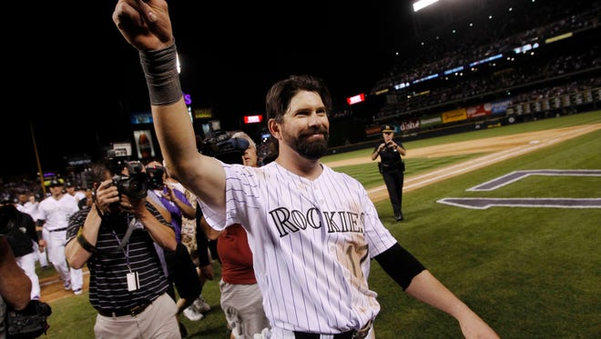 After playing his final game at home, Colorado Rockies first baseman Todd Helton acknowledges the fans after the Boston Red Sox's 15-5 victory in a baseball game in Denver on Wednesday, Sept. 25, 2013.