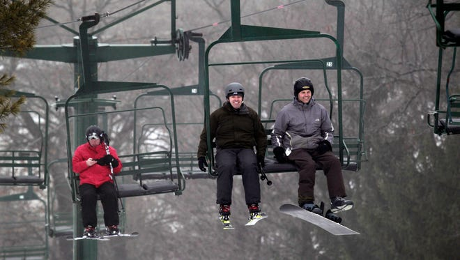 Members take the chairlift to the top of the slopes at Ausblick Ski Club in Sussex last month.