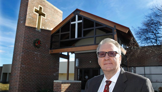 Pastor Michael Hook stands outside True Life Church in Waukesha. The church has been sued by creditors who want the church to return $756,000 it received from a company that filed for bankruptcy.