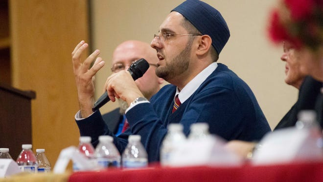 Didmar Faja, the imam of the United Islamic Center of Arizona, participates in a panel discussion at the center in Phoenix on Saturday, Feb. 18, 2017. The event was organized as an interfaith open house to educate the community about the Muslim faith.