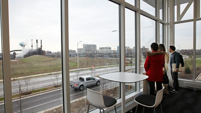 Visitors tour the UWM Innovation Campus accelerator building and the laboratories it contains.