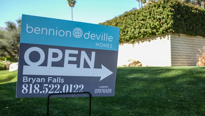 A home for sale sign in the Little Tuscany neighborhood in Palm Springs on Thursday, February 23, 2017.