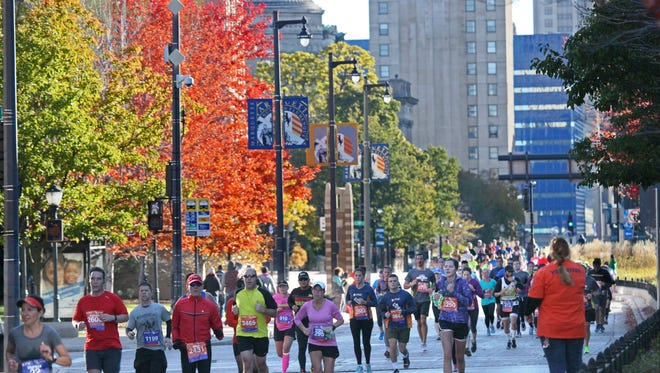 Runners participate in the inaugural PNC Milwaukee Running Festival in 2015 along Wisconsin Ave. near the Marquette University campus.
