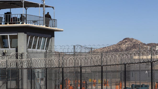 The maximum-security facility at the Arizona State Prison Complex-Lewis, in Buckeye, is part of the complex's Rast Unit. The photo shows inmates in a recreational area at the Rast Unit on Nov. 7, 2014.