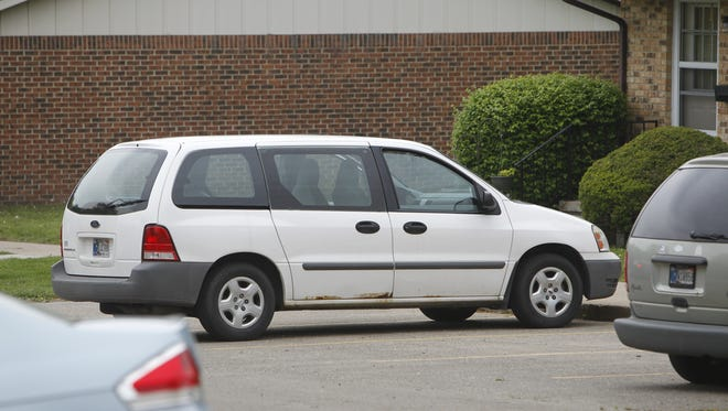 Attica police say they found two bombs inside this white van and arrested its owner, Robert William Bandy II.