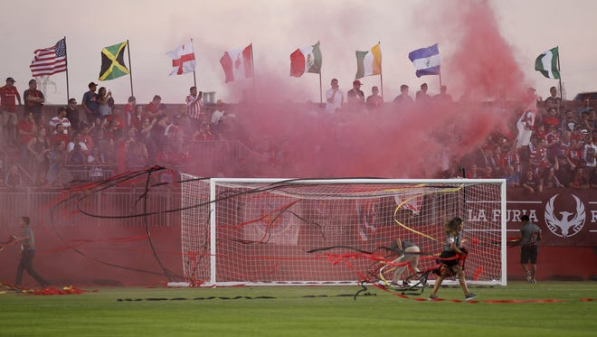 Fans of Phoenix Rising FC fill the stands and throw streamers before a game against the Swope Park Rangers at the Phoenix Rising Soccer Complex on Sunday, April 23, 2017.