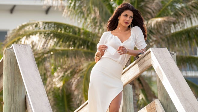 """This image released by Paramount Pictures shows Priyanka Chopra as Victoria Leeds in """"Baywatch."""" (Frank Masi/Paramount Pictures via AP)"""