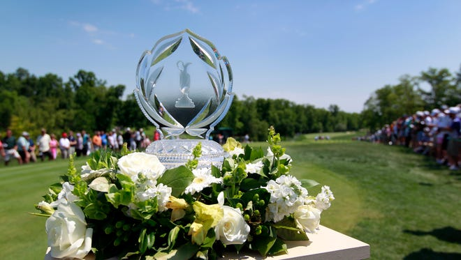 Jun 3, 2017; Dublin, OH, USA; The Memorial Tournament Trophy sits on hole one during the third round at Muirfield Village Golf Club. Mandatory Credit: Caylor Arnold-USA TODAY Sports