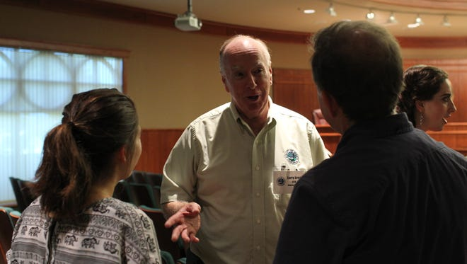 Shasta County Executive Officer Larry Lees speaks with two people at the CityConnect event Saturday, where people had the chance to meet with public leaders.